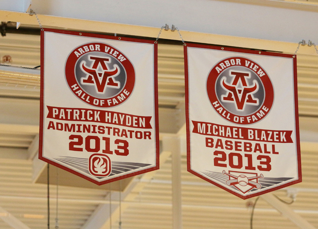 A banner honoring former principal Pat Hayden, at left, hangs in Arbor High School's Athletic Hall of Fame in the gymnasium at Arbor View High School Wednesday, June 17, 2015, in Las Vegas. Hayden ...