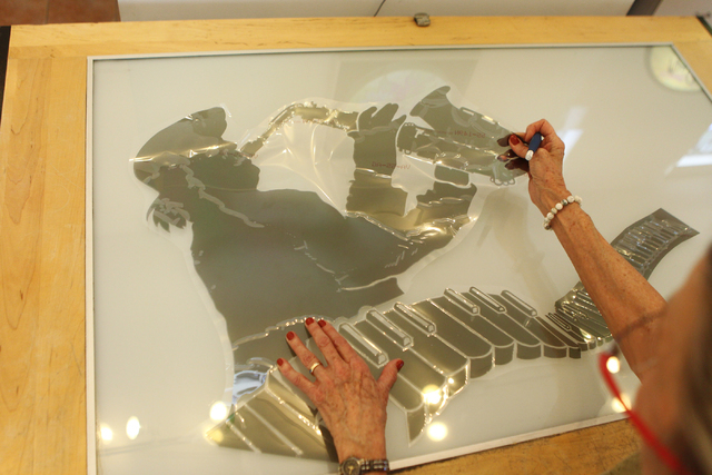 Austine Wood Comarow works on a custom art piece for a client at her studio in Las Vegas Monday, June 22, 2015. (Erik Verduzco/Las Vegas Review-Journal) Follow Erik Verduzco on Twitter @Erik_Verduzco