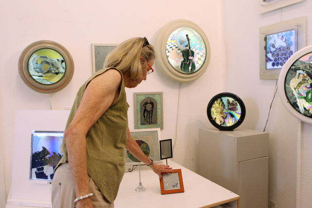 Austine Wood Comarow shows art pieces inside her studio in Las Vegas Monday, June 22, 2015. Comarow is internationally known for using polarized light collages to make art pieces. (Erik Verduzco/L ...