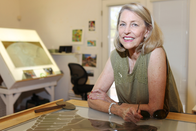Austine Wood Comarow  poses for a photo inside her studio in Las Vegas Monday, June 22, 2015. Comarow is internationally known for using polarized light collages to make art pieces. (Erik Verduzco ...
