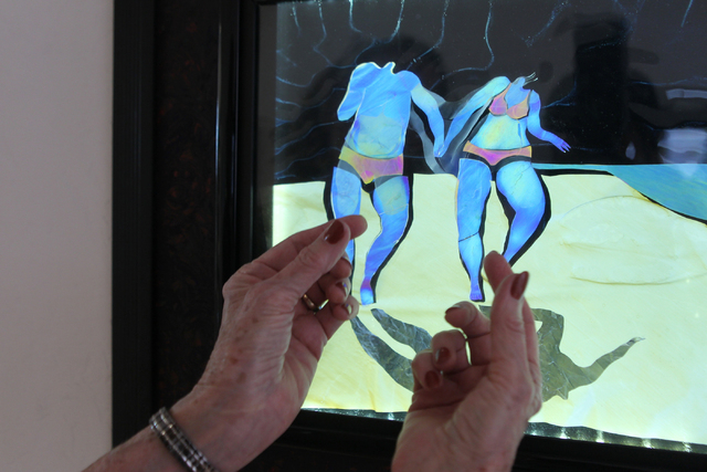 Austine Wood Comarow shows an art piece inside her studio in Las Vegas Monday, June 22, 2015. Comarow is internationally known for using polarized light collages to make art pieces. (Erik Verduzco ...