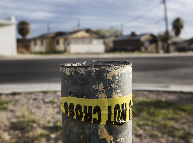 Police tape as seen Monday at 800 N. Tonopah across the street from where a person was killed in an officer-involved shooting in North Las Vegas. This is the North Las Vegas police department's fi ...