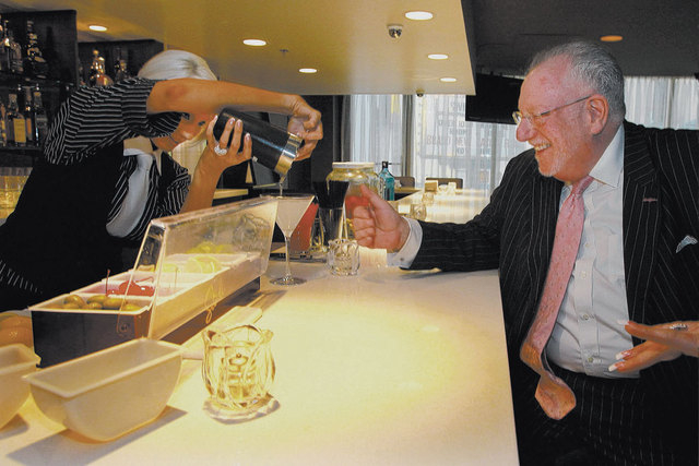 Former Las Vegas Mayor Oscar Goodman watches while bartender Tiffinie Smithe pours him a martini at Oscar's Beef, Booze, Broads at The Plaza. Goodman will give a talk at his restaurant June 11. (J ...