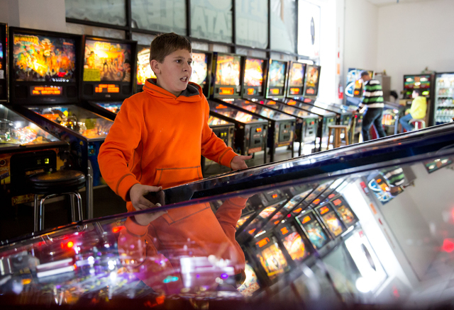 Benjamin Eldredge plays a pinball machine at the Pinball Hall of Fame, located at 1610 E. Tropicana Ave., Tuesday, Dec. 31, 2013. (Samantha Clemens/Las Vegas Review-Journal)
