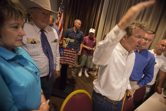 Republican presidential candidate Rand Paul, right, speaks to supporters while Cliven Bundy, center, and his wife Carol stand near him Monday, June 29, 2015 during a rally at the Eureka Casino in  ...