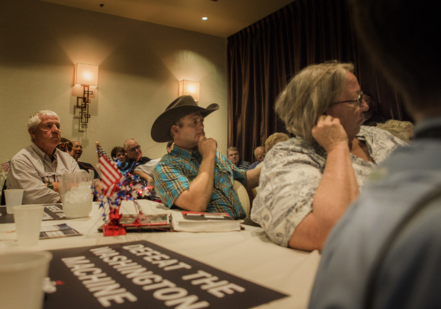 Ryan Bundy, son of rancher Cliven Bundy, listens while Republican presidential candidate Rand Paul speaks to supporters Monday, June 29, 2015 during a rally at the Eureka Casino in Mesquite. Follo ...