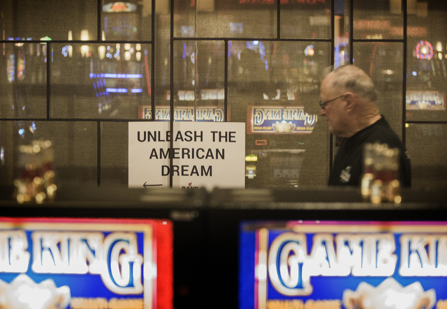 A man walk passed a bank of video poker machines to listen to Republican presidential candidate Rand Paul Monday, June 29, 2015 during a rally at the Eureka Casino in Mesquite. Follow Jeff Scheid  ...