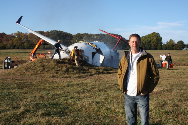 "Doug Scroggins poses next to the ""crashed"" MD-80 jetliner his company supplied for the 2012 Denzel Washington film ""Flight."" Scroggins said the aircraft was carefully damaged beforehand, then ship ..."