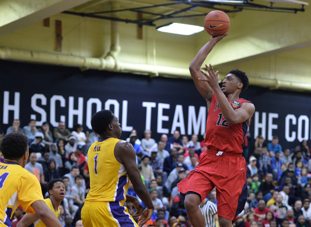 Findlay Prep Pilots junior Justin Jackson (12) shoots the ball over Montverde Academy Eagles senior Noah Dickerson (1) during the second round game between #2 seed Montverde Academy and #6 seed Fi ...