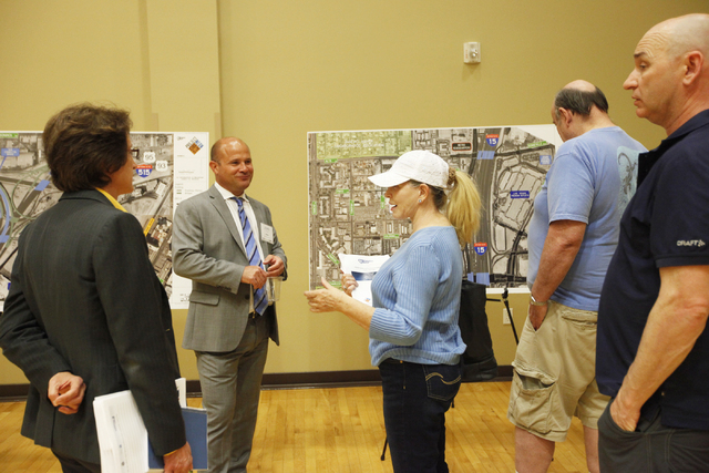 Project Consultant John Taylor, second from left, speaks with meeting attendees on Wednesday, June 10, 2015, in Las Vegas. A public meeting was held regarding the overhaul of the Spaghetti Bowl. ( ...