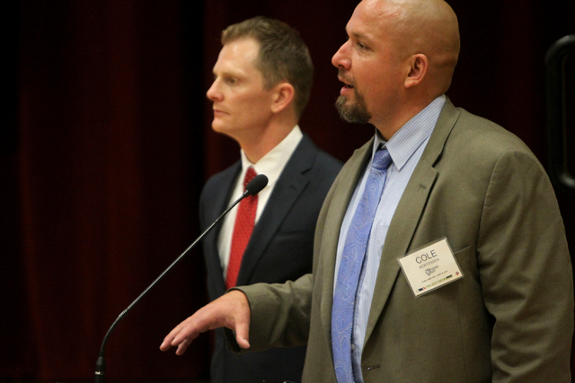 Dale Keller, left, and Cole Mortensen answer questions at a public meeting on Wednesday, June 10, 2015, in Las Vegas. A public meeting was held regarding the overhaul of the Spaghetti Bowl. (James ...