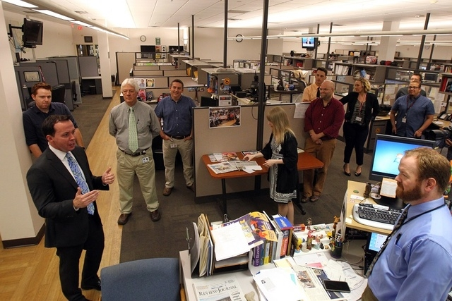 New Las Vegas Review-Journal Publisher Jason Taylor, lower left, introduces himself to Review-Journal reporters and editors at the RJ offices in Las Vegas on Thursday, June 11, 2015. (K.M.  Cannon ...