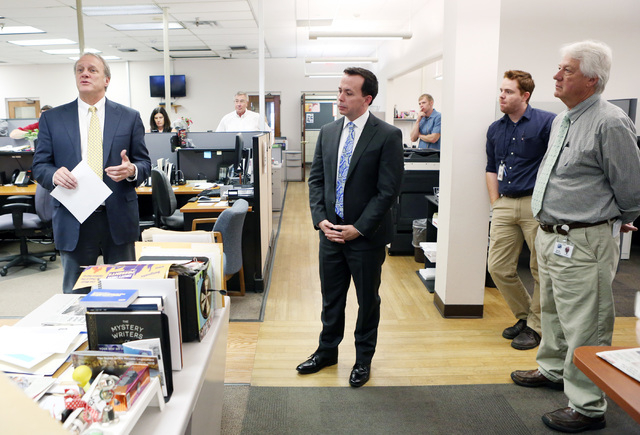 Kirk Davis, CEO GateHouse Media, left, announces in the newsroom that Jason Taylor, center, has been named President and Publisher of the Review-Journal and President of GateHouse Media's Western  ...