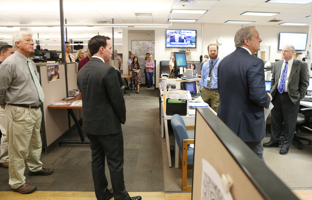 Kirk Davis, CEO GateHouse Media, second right, announces in the newsroom that Jason Taylor, second left, has been named President and Publisher of the Review-Journal and President of GateHouse Med ...