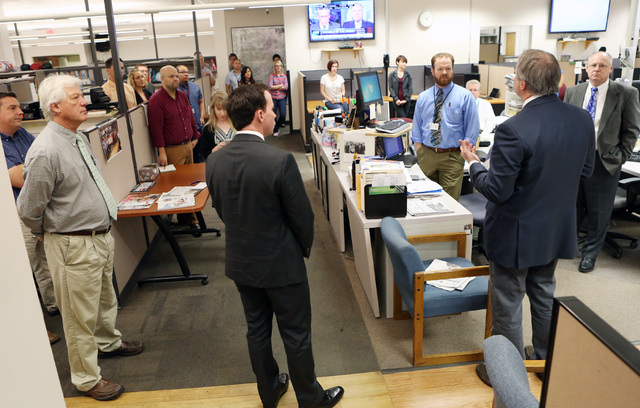 Kirk Davis, CEO GateHouse Media, right, announces in the newsroom that Jason Taylor, second left, has been named President and Publisher of the Review-Journal and President of GateHouse Media's We ...