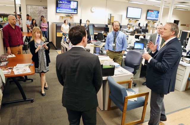 Kirk Davis, CEO GateHouse Media, right, announces in the newsroom that Jason Taylor, left, has been named President and Publisher of the Review-Journal and President of GateHouse Media's Western U ...