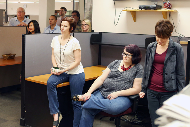 Employees at Review-Journal listen as Kirk Davis, CEO GateHouse Media, not photographed, announces in the newsroom that Jason Taylor has been named President and Publisher of the Review-Journal an ...