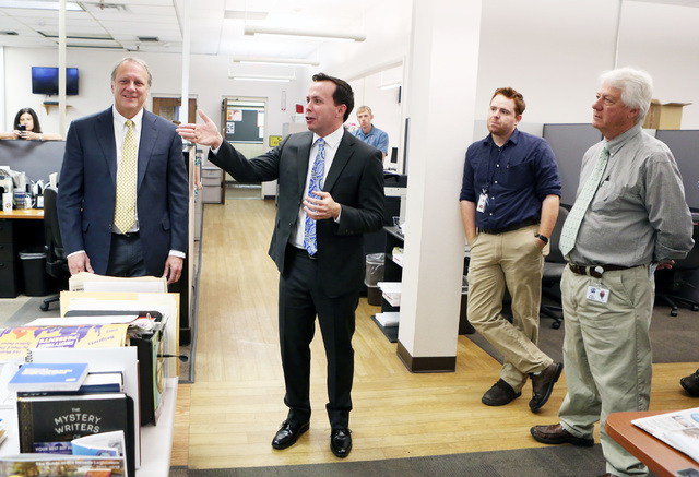 Kirk Davis, CEO GateHouse Media, left, listens as Jason Taylor, center, newly named President and Publisher of the Review-Journal and President of GateHouse Media's Western U.S. Publishing Operati ...