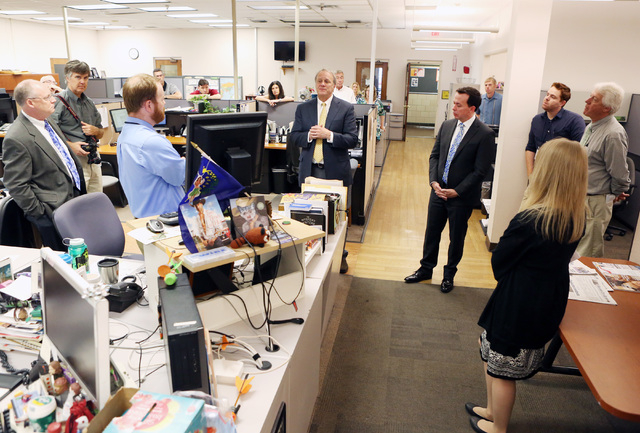 Kirk Davis, CEO GateHouse Media, center, announces in the newsroom that Jason Taylor, center right, has been named President and Publisher of the Review-Journal and President of GateHouse Media's  ...