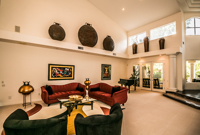 The Large Sunken Living Room With Multiple Focal Points A Two Sided Fireplace A Grand Piano And A 1 000 Gallon Aquarium The Flooring Throughout The Downstairs Is Marble And Custom Carpeting