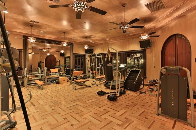 Courtesy photo  Gyms are always good dad spaces. This $25 million Spring Valley home features an upscale one in a 14,192-square-foot recreation building