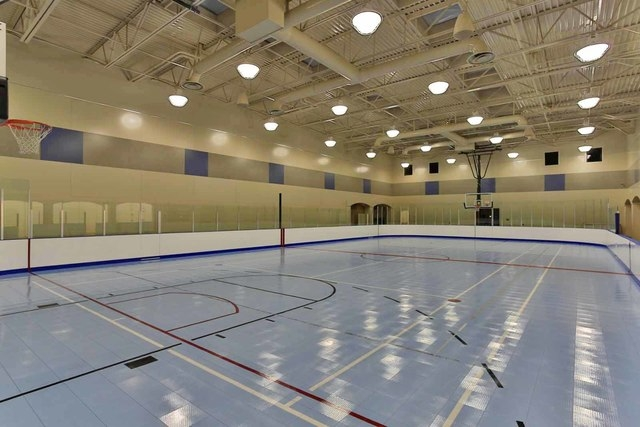 With its own 14,192-square-foot recreation building, this Spring Valley home, has its own indoor roller hockey and basketball court.  (Courtesy photo)
