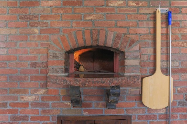 The outdoor kitchen has a brick pizza oven.  (Courtesy photo)