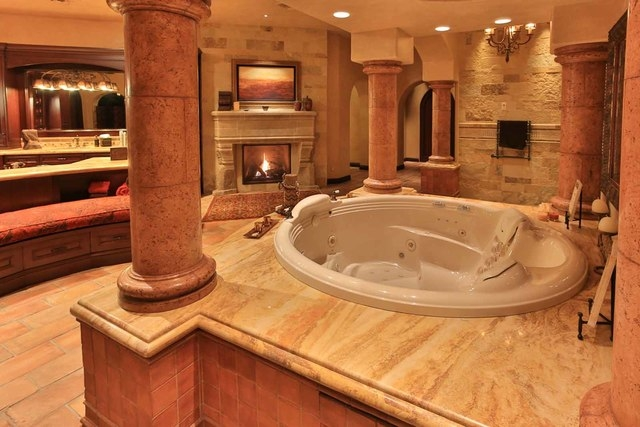 The master bath has a spa tub and fireplace.  (Courtesy photo)