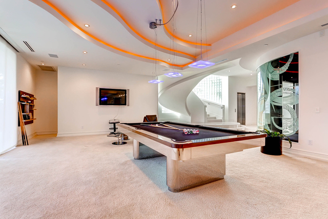 Courtesy photo  A modern-looking game room with pool table is a dad space in this $9.9 million property in Queensridge.