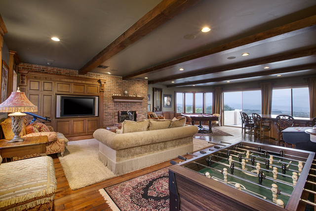 Courtesy photo  Courtesy photo TVs and table games are all part of the game room at this Anthem Country Club, which has been listed for nearly $1.9 million, has one.