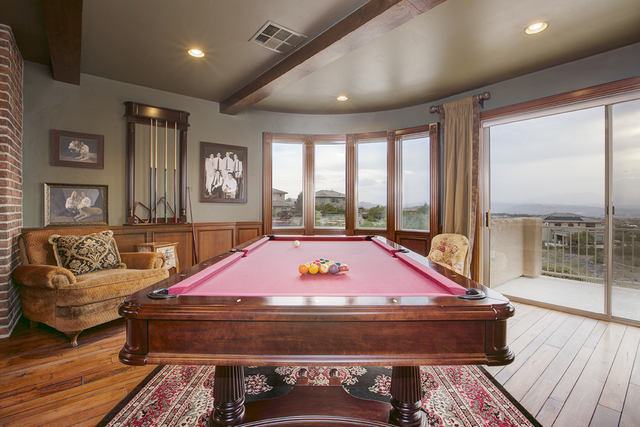 Courtesy photo Pool tables are an important of very game room. This Anthem Country Club, which has been listed for nearly $1.9 million, has one.
