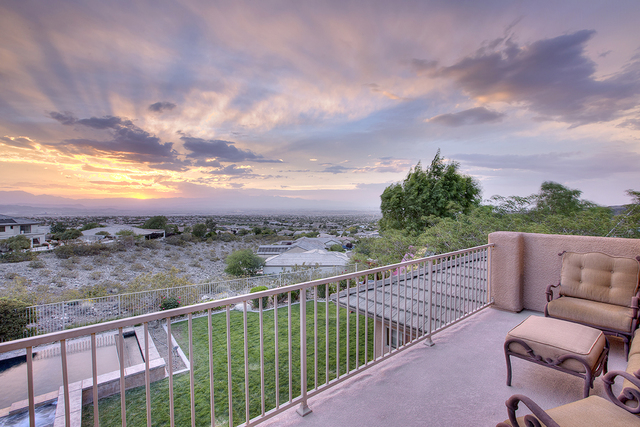 Courtesy photo California commercial developer Tommy Isola had his Anthem Country Club built for the family. This balcony is adjacent to the game room on the second floor. The home has been recent ...