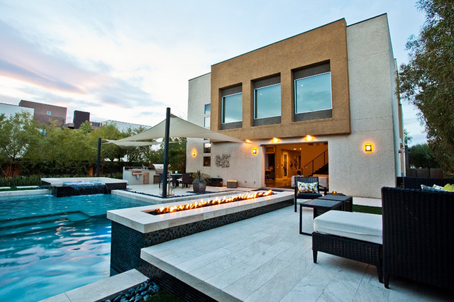 Courtesy photo A 3,800-square-foot modern, Blue Heron retreat in a small luxury enclave in the southwest valley has a glass panel wall in the living room slides open, offering access to a T-shaped ...