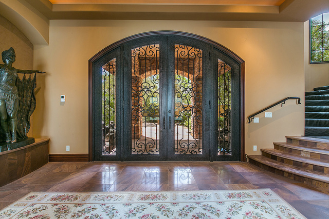 Courtesy photo Passing through the home's immense, ornately wrought front door, a stunning scene greets visitors. The front alcove looks onto a vast, glass-walled indoor water feature.