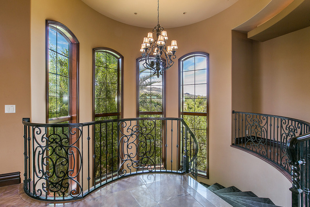Throughout much of the home, milled stonework makes for elegant flooring that complements the sturdy yet graceful architecture, which features a frequent arched theme that is carried from the exte ...