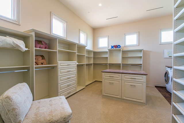 The master bedroom has a shelf-filled walk-in closet with laundry facilities.  (Courtesy photo)
