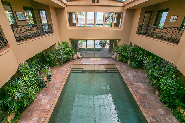 Courtesy photo The front alcove looks onto a vast, glass-walled indoor pool. The area has humidity- and temperature-controlled system. The filtration process is salt- and chemical-free, and its co ...