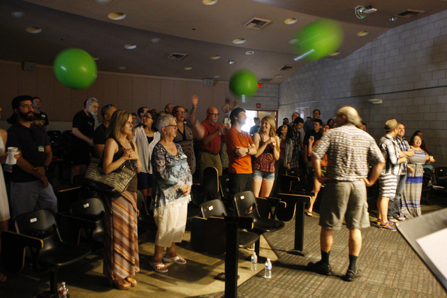"""People sing along to music as balloons float around the room during an event by the Sunday Assembly, an """"atheist church,"""" at UNLV in Las Vegas Sunday, June 14, 2015. (Erik Verduzco/Las Vegas Revie ..."""