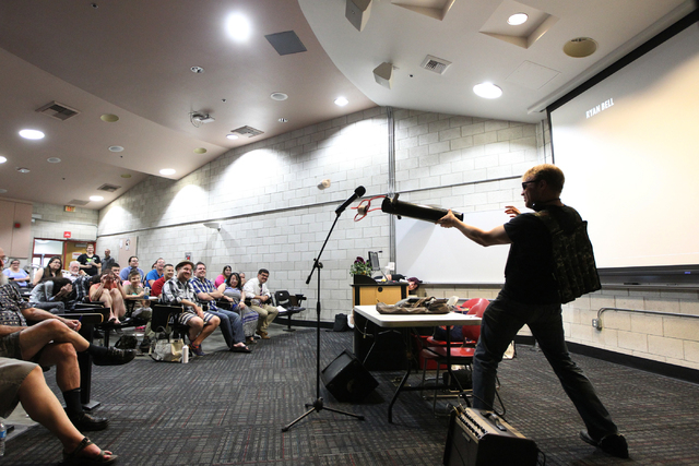 Kevin Breen, organizer for Sunday Assembly, an atheist church, launches free shirts to the audience during a Sunday Assembly event at UNLV in Las Vegas Sunday, June 14, 2015. (Erik Verduzco/Las Ve ...