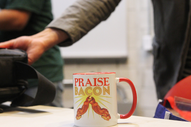 A mug from the United Church of Bacon sits on a table during an event by the Sunday Assembly, an atheist church, at UNLV in Las Vegas Sunday, June 14, 2015. (Erik Verduzco/Las Vegas Review-Journal ...
