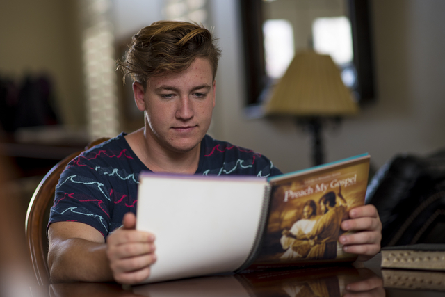 Cole Ballard, 18, studies for his two-year mission trip to Chile at his home in Henderson on Wednesday, May 13, 2015. (Joshua Dahl/Las Vegas Review-Journal)