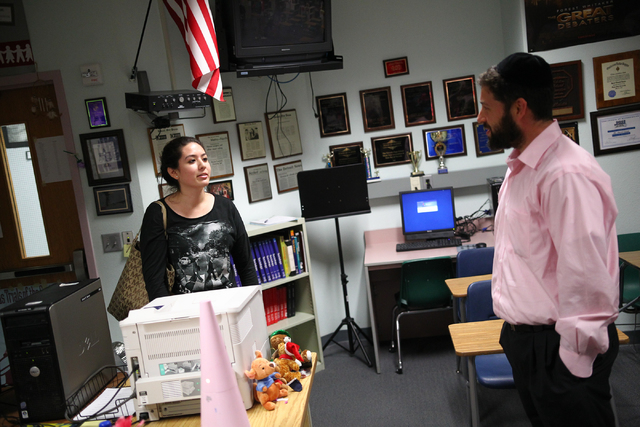 Rabbi Yahuda Maryles, right, speaks with Ariadna Gutierrez after a Jewish Student Union meeting at Advanced Technologies Academy in Las Vegas on Friday, May 9, 2014. (Chase Stevens/Las Vegas Revie ...