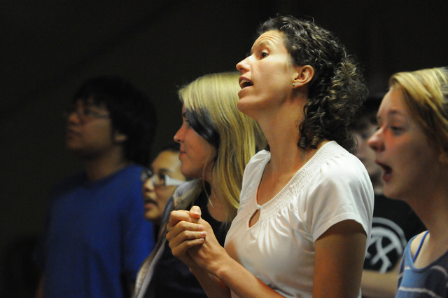 Kira Ward, center, adult leader at Community Lutheran Church in Las Vegas, and member Abby Holter, right, sing along during a youth band music session at the church Thursday, May 8, 2014. (Erik Ve ...