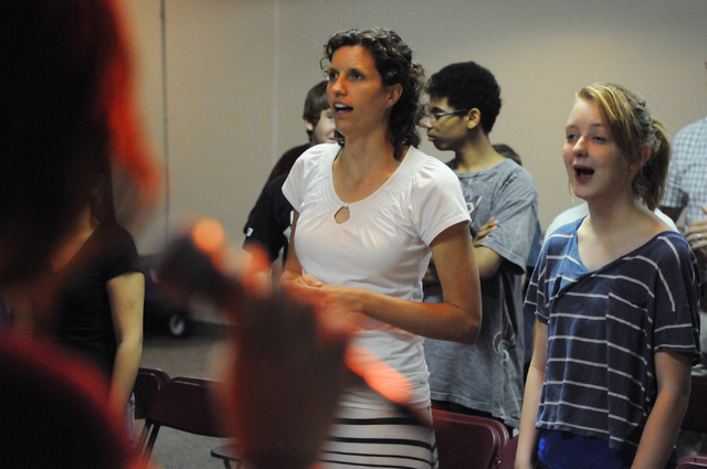 Kira Ward, left, adult leader at Community Lutheran Church in Las Vegas, and member Abby Holter, 14, sing along during a youth band music session at the church Thursday, May 8, 2014. (Erik Verduzc ...
