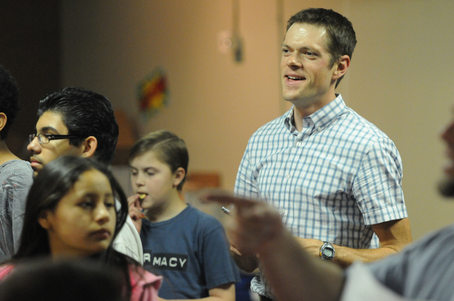 Associate Pastor Brian Ward, right, sings along during a youth band music session at Community Lutheran Church in Las Vegas Thursday, May 8, 2014. (Erik Verduzco/Las Vegas Review-Journal)