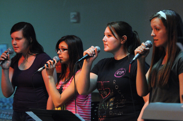 Youth band singers Lynsey Fitch, from left, Sarah Ayala, Francesca Bergeret-Simpson, and Ally Cooley, perform a song in front of other children at Community Lutheran Church in Las Vegas Thursday,  ...