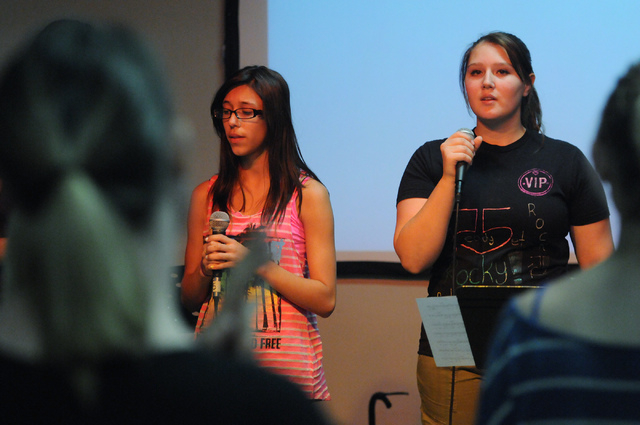 Youth band singers Sarah Ayala, left, and Francesca Bergeret-Simpson, perform a song in front of other children at Community Lutheran Church in Las Vegas Thursday, May 8, 2014. (Erik Verduzco/Las  ...
