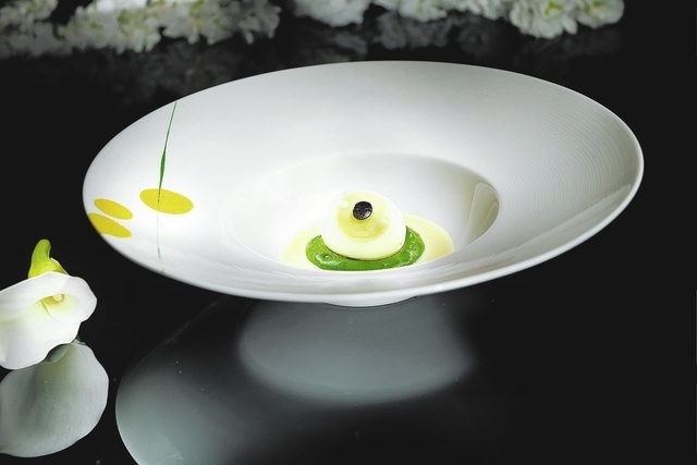 For the l'oeuf de poule, Chef Robuchon uses a crisply coated soft-boiled egg as the centerpiece of the dish that also features smoked salmon and oscetra caviar. (Courtesy)