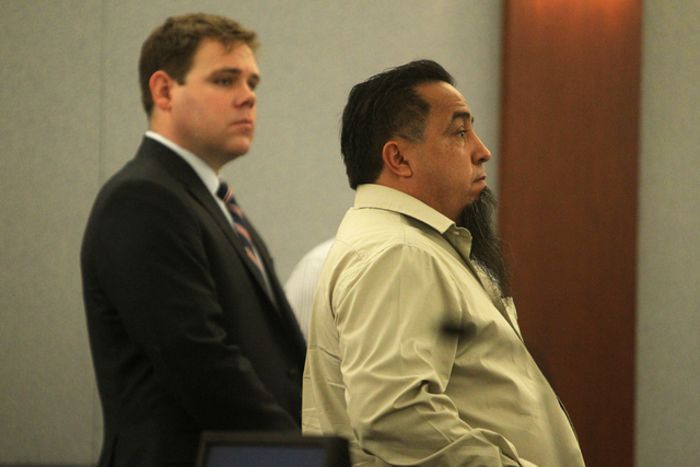 Jerome Rocha, right, listens to Judge Susan Johnson at the Regional Justice Center on Tuesday, June 30, 2015, in Las Vegas. Rocha plead guilty to stealing hundreds of thousands of dollars from the ...