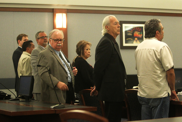 Priscilla Rocha, second from right, listens to Judge Susan Johnson at the Regional Justice Center on Tuesday, June 30, 2015, in Las Vegas. Rocha plead guilty to stealing hundreds of thousands of d ...